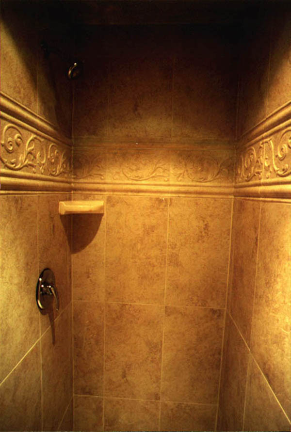 Name Of Tile: Porcellain 12x24, With Roman Style Border. Installation  Pattern: Straight With Small Grout Joints.